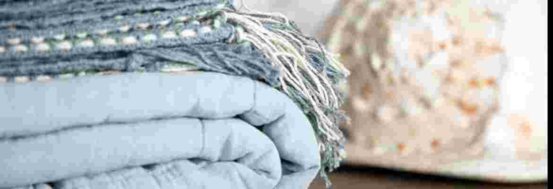 Plaider, quilts, tæpper og skind